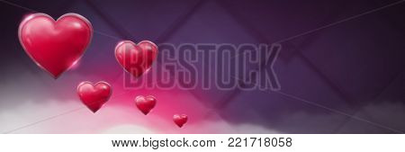 Digital composite of Shiny bubbly Valentines hearts with purple misty background