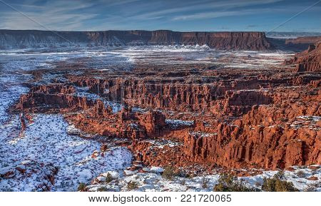 Sandstone formations covered with snow in Professor Valley near Moab. Fisher towers. Utah. United States.