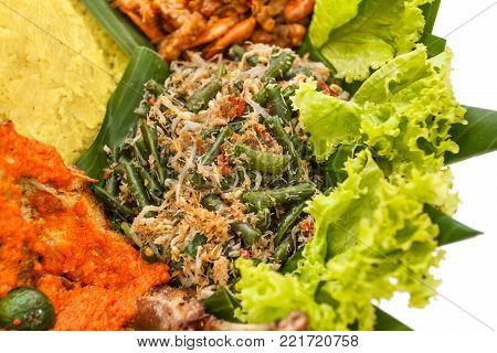 portrait of traditional indonesian food, urap on nasi tumpeng