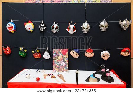 Hokkaido, Japan - 28 December 2017 - Japanese cartoon and traditional folk character masks and other traditional games are set up by hotel staff for their guests to play with at Eclipse hotel in Hokkaido, Japan on December 28, 2017