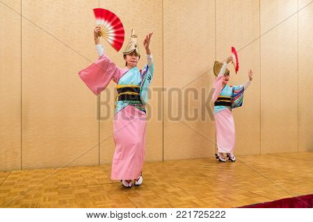 Hokkaido, Japan - 28 December 2017 - Japanese local performers in traditional Japanese dress perform traditional local Japanese style dance for hotel guests at Eclipse hotel in Hokkaido, Japan on December 28, 2017