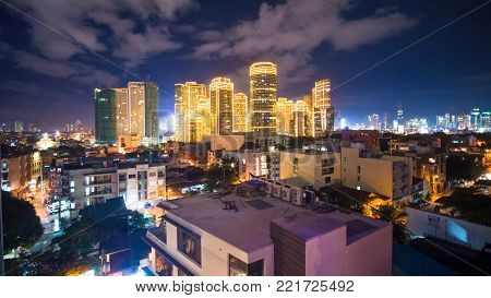 Time lapse view of Makati skyscrapers in Manila city. Skyline at night, Philippines