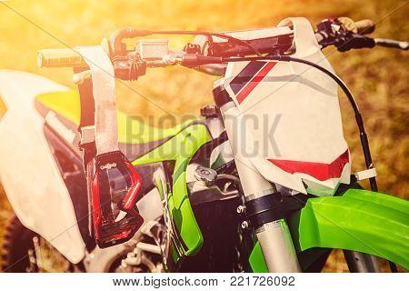 Motocross. Dirtbike, goggles against dirt, motorcycle steering