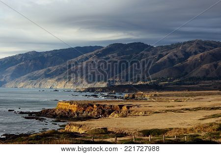 Cliffs and mountains landscape on Pacific Ocean near Big Sur, Central Coast, California before autumn storm.