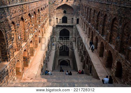 NEW DELHI, INDIA - CIRCA NOVEMBER 2017: Underground step-well Ugrasen ki Baoli in heart of New Delhi, India. 14th Century AD. Protected monument and built by Maharaja Agrasen in the Mahabharat era.