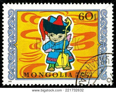 Ukraine - circa 2018: A postage stamp printed in Mongolia shows Young musician. Series: International Childrens Day. Circa 1976.