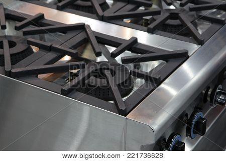 Kitchen burning gas cooker, modern kitchenware, selective focus