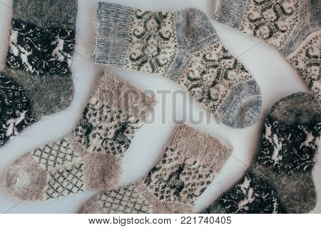 Handmade Knitted Socks For The Cold Season. View From Above. Many Different Blue Color Socks.