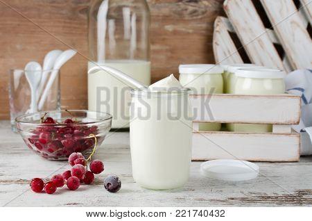 Fresh natural homemade organic yogurt with berries in a glass jar