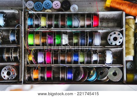 Coils with colorful threads. Textile industry. Macro