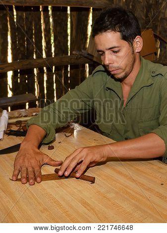 Vinales, Cuba - December 5, 2017: Cuban peasant preparing an artisan cigar in Vinales (Cuba)
