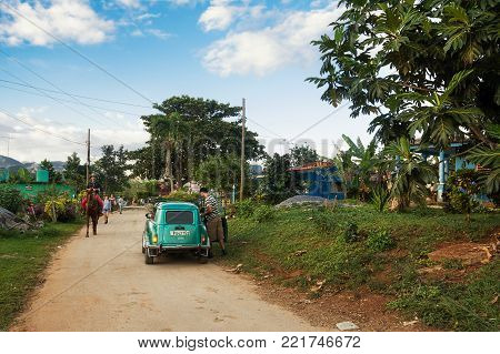 Vinales, Cuba - December 5, 2017: Old 1950s car parked in the secondary road of Vinales