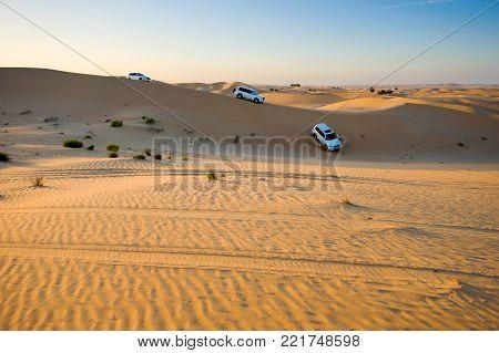 ABU DHABI, UNITED ARAB EMIRATES - 30 DEC, 2017: Four wheel drive through the desert in the United Arab Emirates.