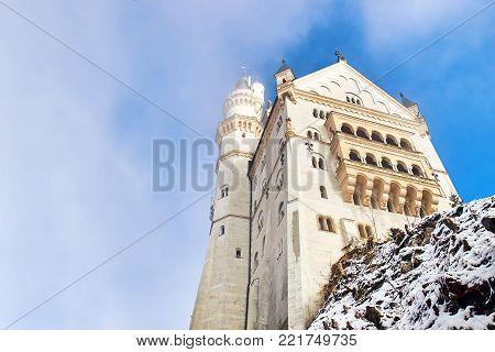Fairytale Neuschwanstein castle during foggy winter day, Germany