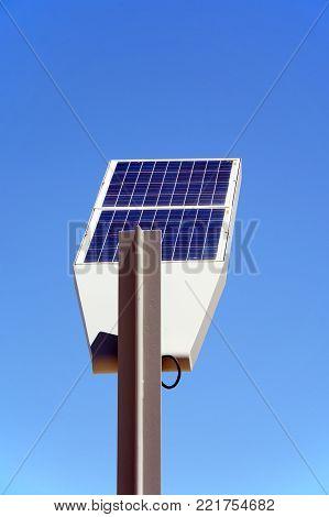 Rear of a solar powered streetlight against a blue sky, Vilamoura, Algarve, Portugal, Europe.