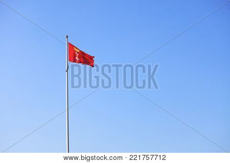 Flag city of Gdansk Danzig in the sky background Poland Europe