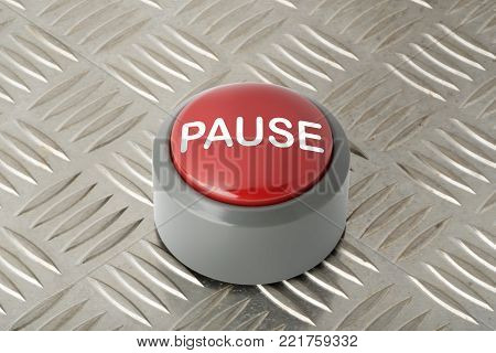 Red circular panic push button labeled 'Pause' on aluminum diamond plate background