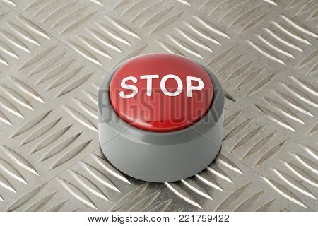 Red circular panic push button labeled 'Stop' on aluminum diamond plate background