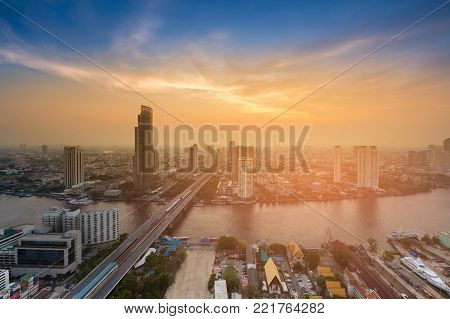 After sunset sky aerial view Bangkok city business downtown Thailand, cityscape background