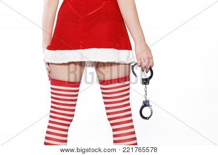 Santa woman from back holding handcuffs,  isolated on white background