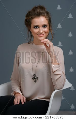Beautiful young fashion woman with elegant earrings and necklace