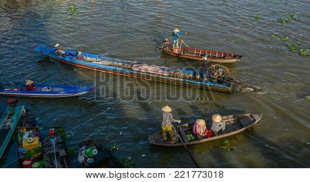 Soc Trang, Vietnam - Feb 2, 2016. Wooden boats running on Mekong River in Soc Trang, Vietnam. Mekong is the world 12th-longest river and the 7th-longest in Asia.