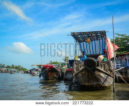Soc Trang, Vietnam - Feb 2, 2016. Cargo boats at floating market on Mekong River in Soc Trang, Vietnam. Mekong is the longest river in Southeast Asia, the 7th longest in Asia.