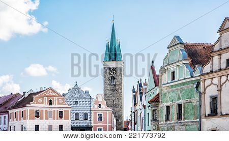 Church of the Holy Spirit and famous 16th-century houses in Telc, Czech republic. Architectural scene. Unesco World Heritage Site.