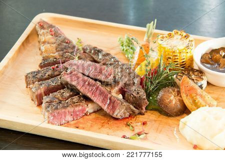 Grilled Tomahawk Beef steak with vegetable and sauce