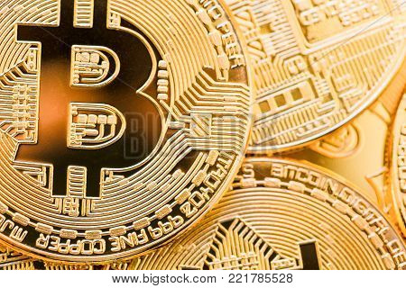 Bitcoins. Physical bit coins. Digital currency. Cryptocurrency. Golden coins with bitcoin. Close-up.