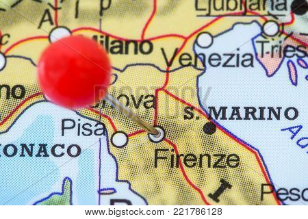 Close-up of a red pushpin in a map of Firenze (Florence), Italy.