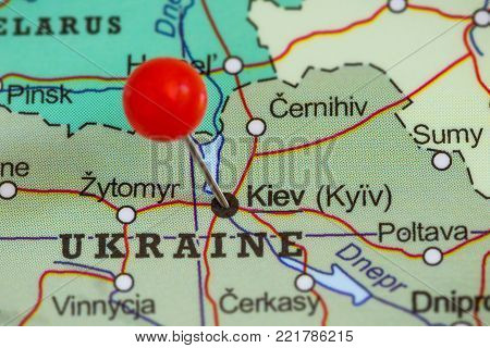 Close-up of a red pushpin on a map of Kiev, Ukraina.