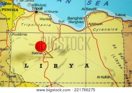 Close-up of a red pushpin on a map of Libya.