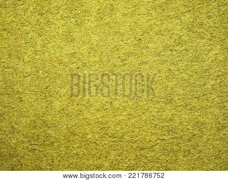 Background. Rough paper. Texture. Color mustard, dark yellow. Old paper. Papyrus.