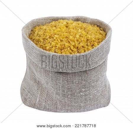 Dry bulgur wheat in bag isolated on white background with clipping path