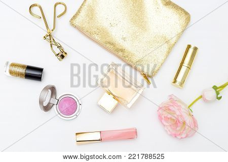 Cosmetics and accessories pink&gold on a white background. Styled flat lay