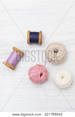 Spool of thread on wooden background. Vertical flat lay