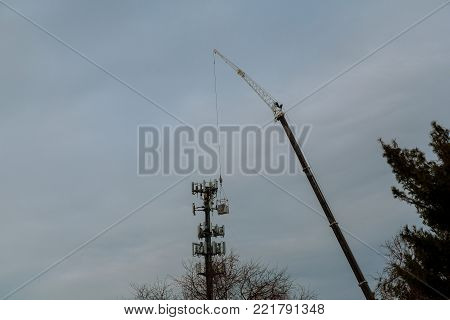 Tower climber and working on cellular tower system. installation of telecommunication tower