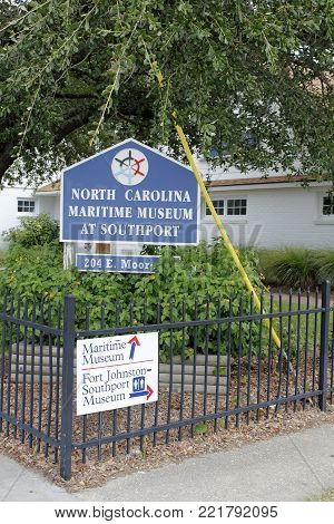 Southport, NC, USA - July 28, 2014: Building sign of North Carolina Maritime Museum at Southport. North Carolina Maritime Museum at Southport front and sign