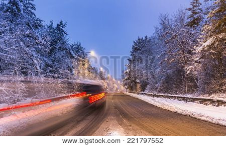 Difficult But Scenic Driving Conditions On The Road At Evening After Recent Heavy Snowfall