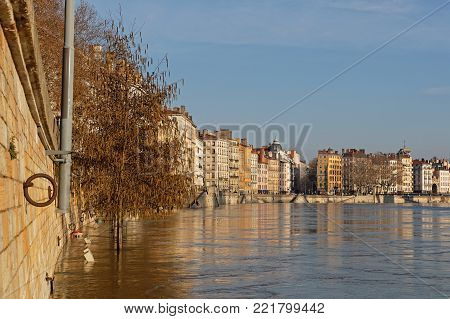 LYON, FRANCE, January 13, 2018 : Floods of the saone river in city center. Saone is open to navigation throughout the year except when it is in flood.