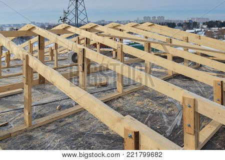 Wooden roofing construction frame, new roof skeleton.