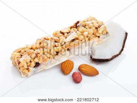 Coconut protein cereal energy bar with almonds on white background