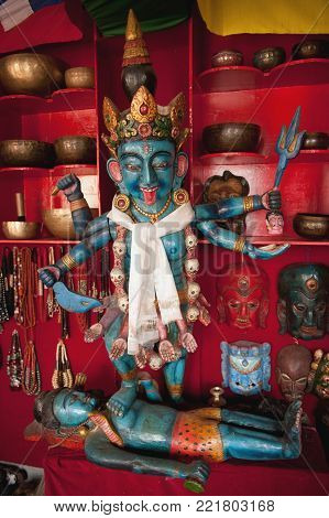 Indian God Parvati and Shiva, blue bodies, sculptures made of wood, antique shop, Nepal.