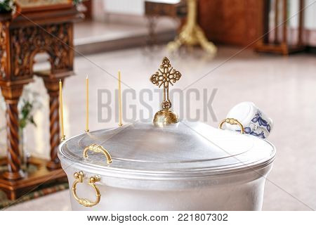 Accessories for the christening of children icons of candles and font, the Ortodox Church. The Sacrament of Children.