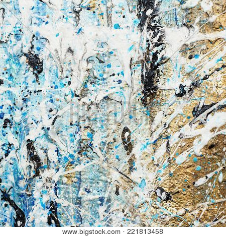 Abstract artistic background with gold, blue, white and black stains on canvas.