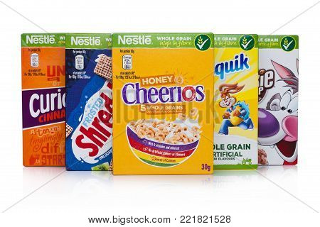 LONDON, UK - JANUARY 10, 2018: Packages of Nestle whole grain ceral for breakfast on white background.Product of Nestle