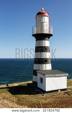 Petropavlovsky Lighthouse (founded in 1850) - oldest lighthouse in Russian Far East, located on Cape Mayachny on Kamchatka on shore of Avacha Gulf in Pacific Ocean, in vicinity of Petropavlovsk City.