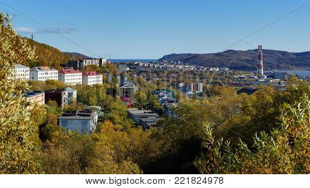 Autumn panorama view of Kamchatka city landscape, old Soviet residential building of Petropavlovsk-Kamchatsky City on sunny clear day with blue sky. Eurasia, Russian Far East, Kamchatka Peninsula.