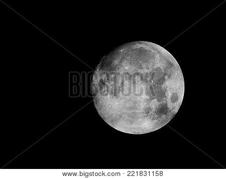 Moon phases as background / The Moon is an astronomical body that orbits planet Earth, being Earth's only permanent natural satellite. It is the fifth-largest natural satellite in the Solar System